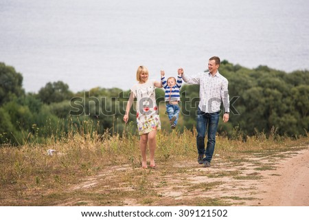 Family stands on a hilltop