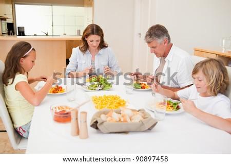 Family started having dinner together - stock photo