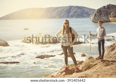 Family taking an afternoon hike along a beautiful coast - stock photo