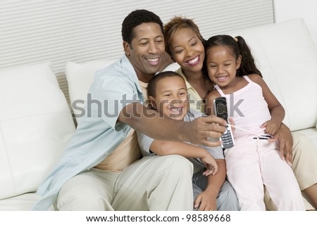 Family Taking Picture with Camera Phone