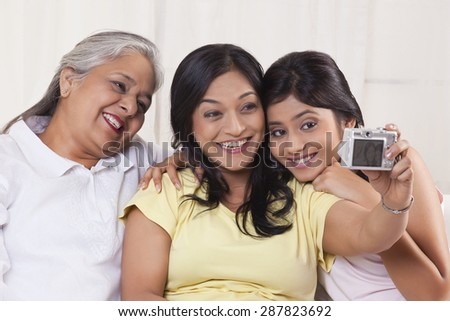 Family taking self-portrait with digital camera - stock photo