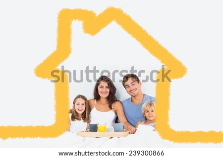 Family taking the breakfast on the bed against house outline