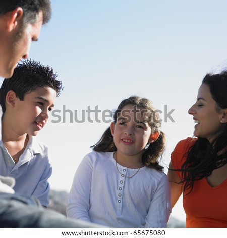 Family talking together - stock photo