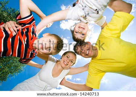 Family team of smiling people holding their hands together - stock photo