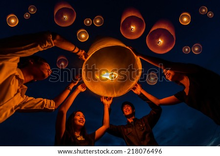 Family - Thai people floating lamp in Yeepeng festival - stock photo