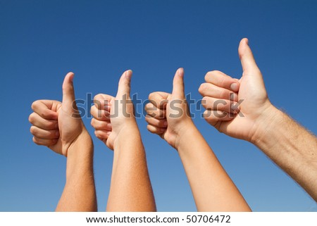 family thumbs up - stock photo