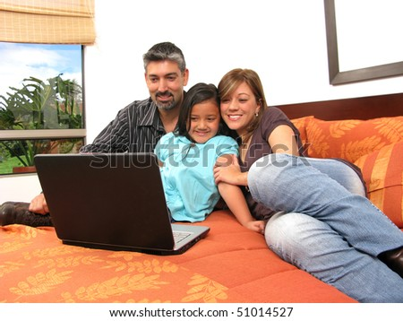 Family to meet in the room look at computer - stock photo