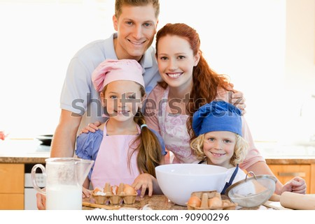 Family together with baking ingredients in the kitchen
