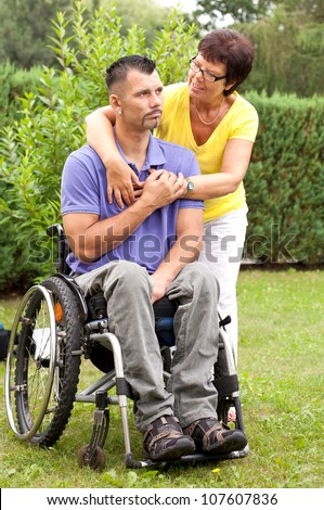 family togetherness with a mother and a disabled young man in wheelchair