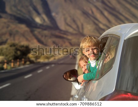 family travel by car-little boy with mother in mountains