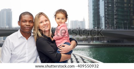 family, travel, tourism and international concept - happy multiracial mother, father and little child over dubai city street background - stock photo