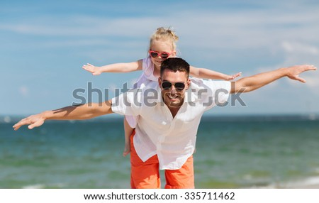 family, travel, vacation, adoption and people concept - happy father with little girl in sunglasses having fun on summer beach - stock photo