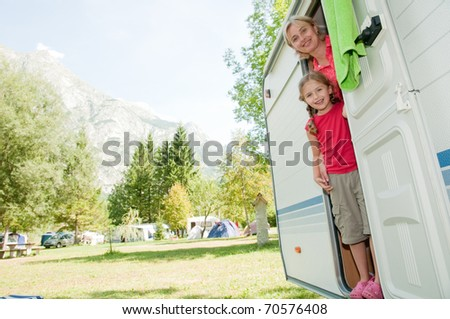 Family vacation in camper - stock photo