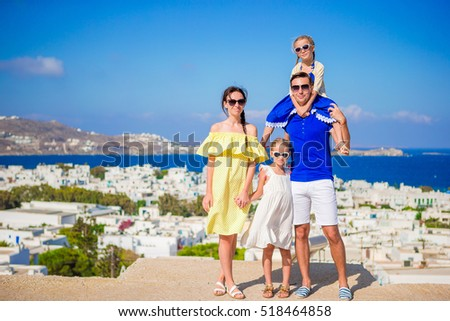 Family Vacation In Europe Parents And Kids Looking At Camera Background Mykonos Island Greece