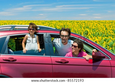 Family vacation. Parents with child in car trip - stock photo
