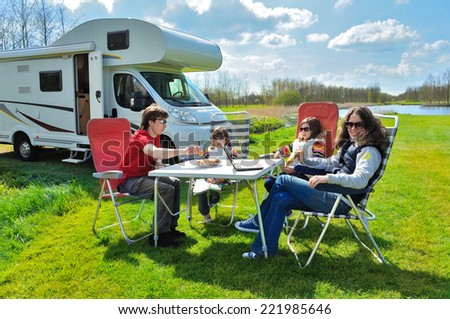 Family vacation, RV (camper) travel with kids, happy parents with children on holiday trip in motorhome  - stock photo