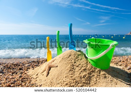 Family vacation with toys in the sand