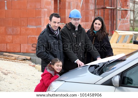 Family visiting construction site - stock photo