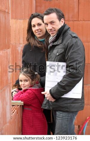 Family visiting site of future home - stock photo