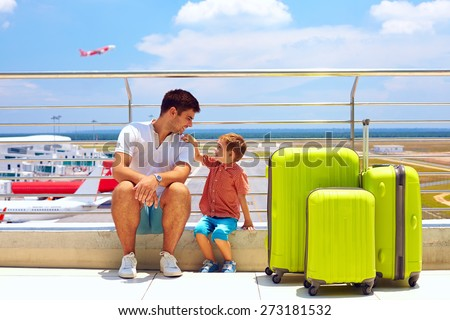 family waiting for boarding in international airport, summer vacation - stock photo