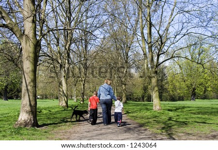 Family walk in the park on a summer's afternoon - stock photo