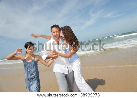 Family walking by the beach in summer