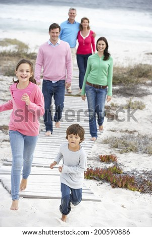 Family walking by the sea - stock photo