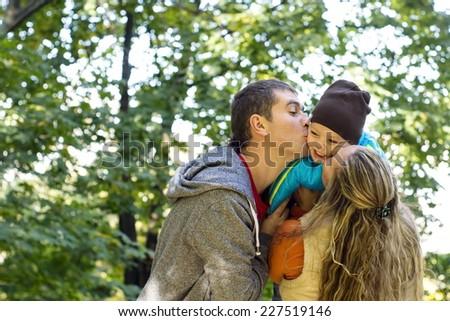Family walking in the autumn park - stock photo