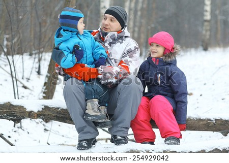 Family walking in winter forest