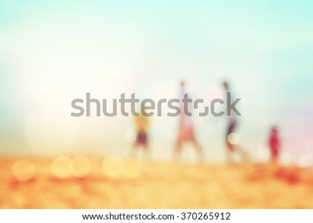 Family walking on the beach, blurred background image, Instagram toned, - stock photo