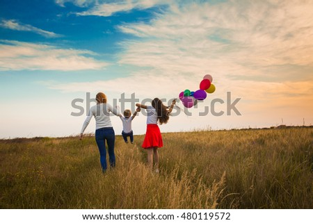 Family walking on the field