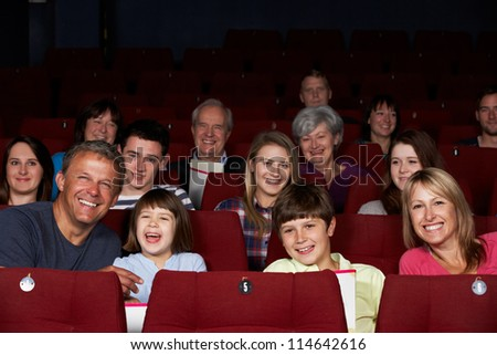 Family Watching Film In Cinema - stock photo
