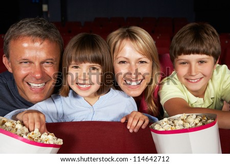Family Watching Film In Cinema - stock photo