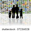 family watching television on huge lcd panel - stock photo