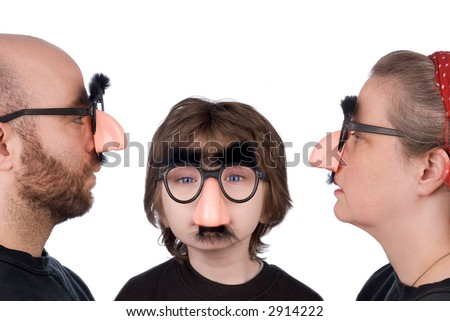 Family wearing fake nose and glasses with mustashe and eyebrows over a white background - stock photo