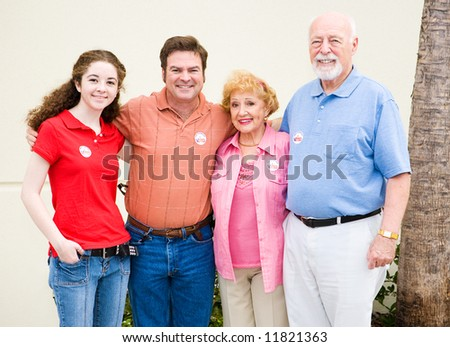 Family wearing their I Voted stickers.  (stickers are generic, not trademarked) - stock photo