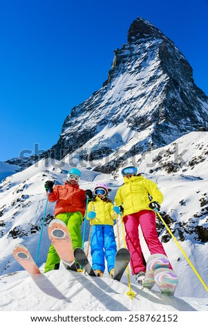 Family winter ski holidays in Zermatt, Switzerland - stock photo