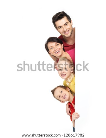 Family with a banner smiling - isolated on a white background - stock photo