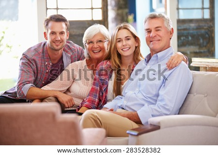 Family With Adult Children Relaxing On Sofa At Home Together - stock photo