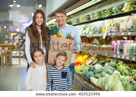 Family with bag in a store