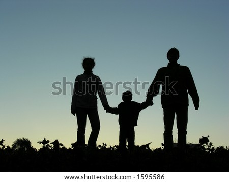 family with boy sundown - stock photo