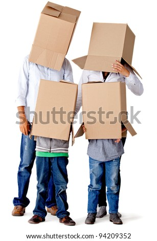 Family with cardboard boxes on their heads in a fun moving day â?? isolated - stock photo