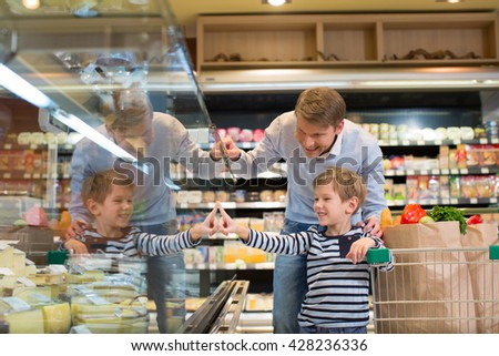 Family with cart in a store