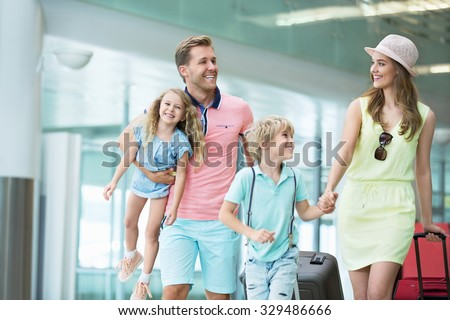 Family with children at the airport - stock photo