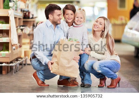 Family with children in a store