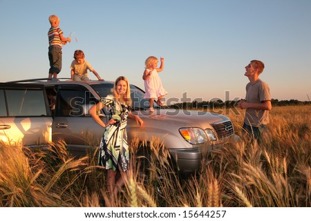 family with children on offroad car - stock photo
