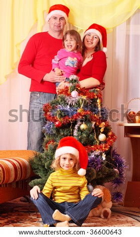 family with christmas fir