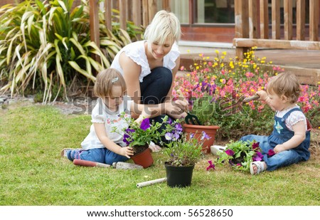 Family with colorful flowers in the garden - stock photo
