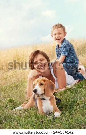 Family with dog have a calm leisure time outdoor - stock photo