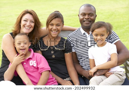 Family with Downs Syndrome son - stock photo